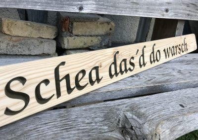 Holzschild mit Spruch